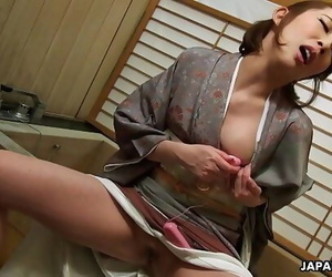 Japanese housewife in a..